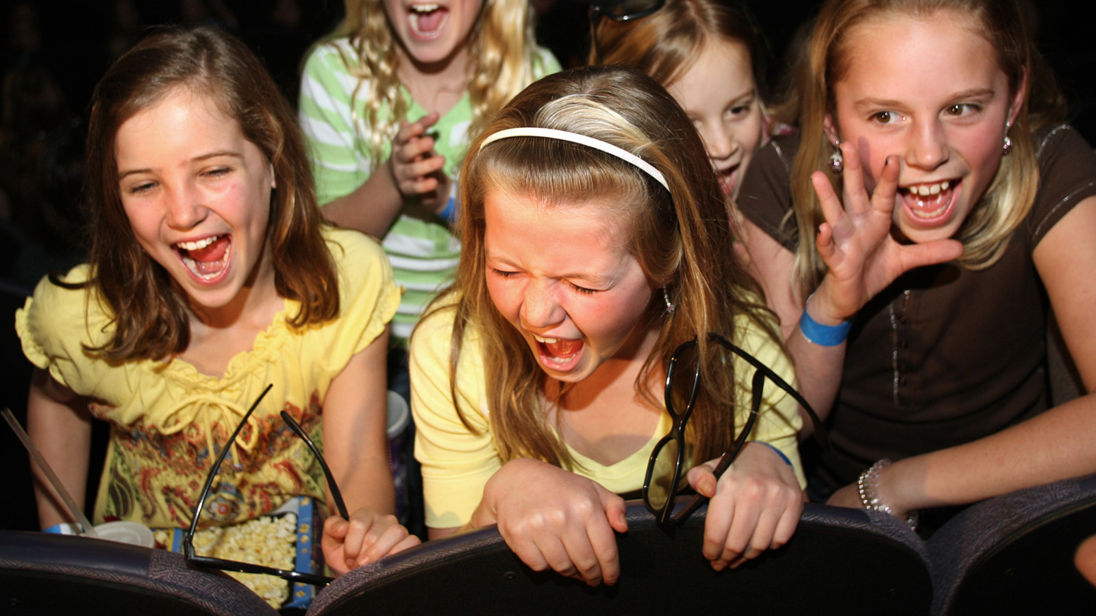 "Abbey Yates, 10, Lila Crump, Meghan Clark, Ellie Crump, back second from right, and Gracie Crump scream for The Jonas Brothers during the brothers' surprise visit to Regal Cinema Hollywood movie theater in the Atlanta suburb of Chamblee, Ga. before watching the ""Jonas Brothers: The 3D Concert Experience"" on Saturday, Feb. 28, 2009. The visit is part of the brother's Surprise Theater invasion, a three-day tour of more than 6,000 miles in 49 hours. (AP Photo / Jenni Girtman)"
